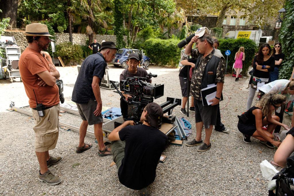 Spanish 1stAD Francesc Prat, Japanese Cinematographer Kaname Onoyama with British directors Stephen Warbeck & John Paul Davidson on set for The Man In The Hat © Photo: Ross Ferguson